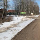 Дорога рядом с поселком зимой