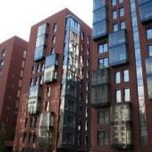 В конструкциях на ул. Ефремова 12 применяли стекло и бетон, отделку и кирпич