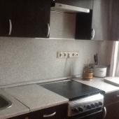Фотография кухни с плитой и вытяжкой