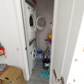 И здесь же рядом с лестницей на второй этаж есть маленькое помещение для стиральных машин и прочих мелочей