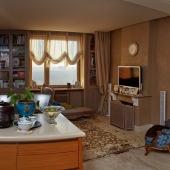 Гостиный холл плавно перетекает в кухонную зону
