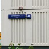 Торец дома с адресом: ул. Беловежская, д. 41